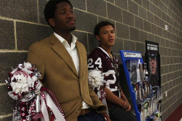 Juniors Jamir Carr and George Haskins wears their garters on Homecoming day.