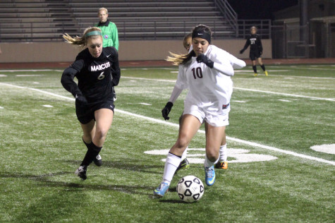 Sophomore Jaylin Finney dribbles the ball away from Marcus on Tuesday, March 4, at Goldsmith Stadium.