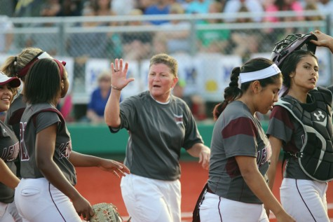 Head coach Lori Alexander offers a high five to third baseman A