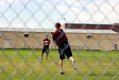 Junior Chris Giordano throws the ball to senior Rylan Martinez.