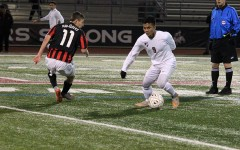 Junior Peter Hmung surpasses junior Kyle Pellino from Marcus in an attempt to score a goal during the game on Jan. 15.