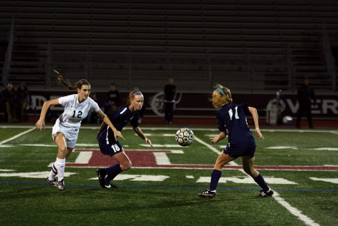 Senior Kandis Hartdegen (12) starts to fight for the ball against two Allen defenders.