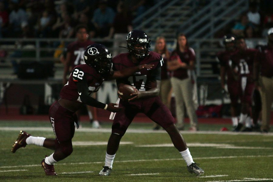 Quarterback+Jarvis+Brooks+%2817%29+hands+the+ball+to+running+back+Kwame+Mickels+%2822%29+at+the+game+on+Friday%2C+Aug.+26+against+the+Rowlett+Eagles.