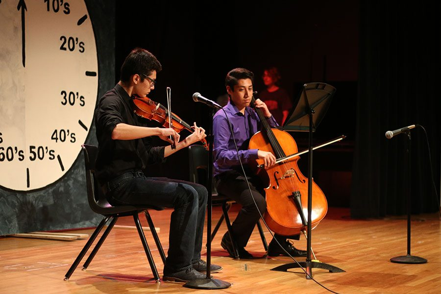Seniors Daniel Mooney and Ulises Moreno perform a string duet of Carol of the Bells by Mykola Leontovych.