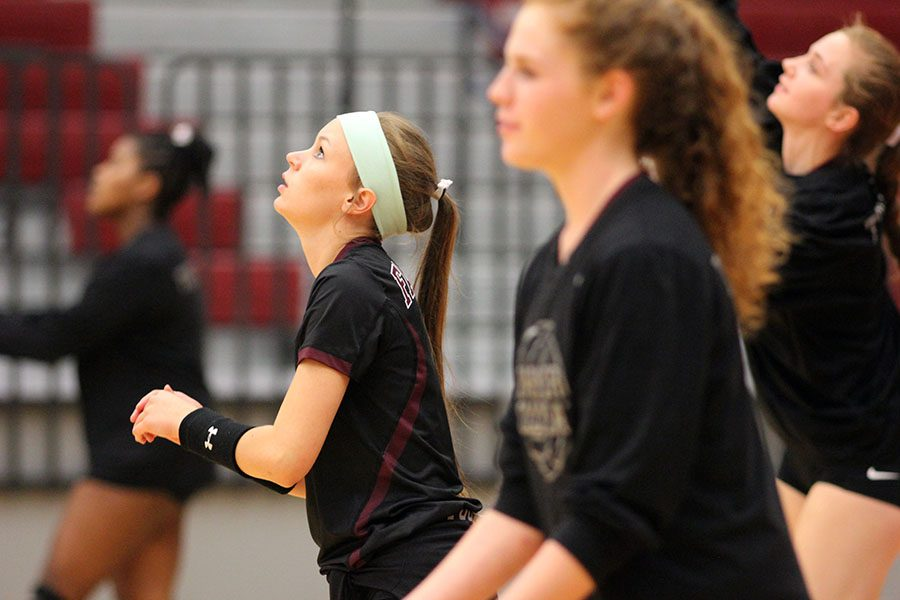 Senior Marie Hartsburg (8) focuses her eyes on the ball as she prepares her move.