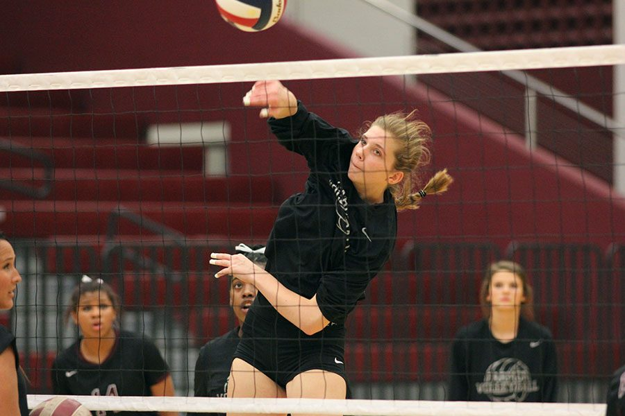 Sophomore Christina Cowsert (3) spikes the volleyball during practice before the game.
