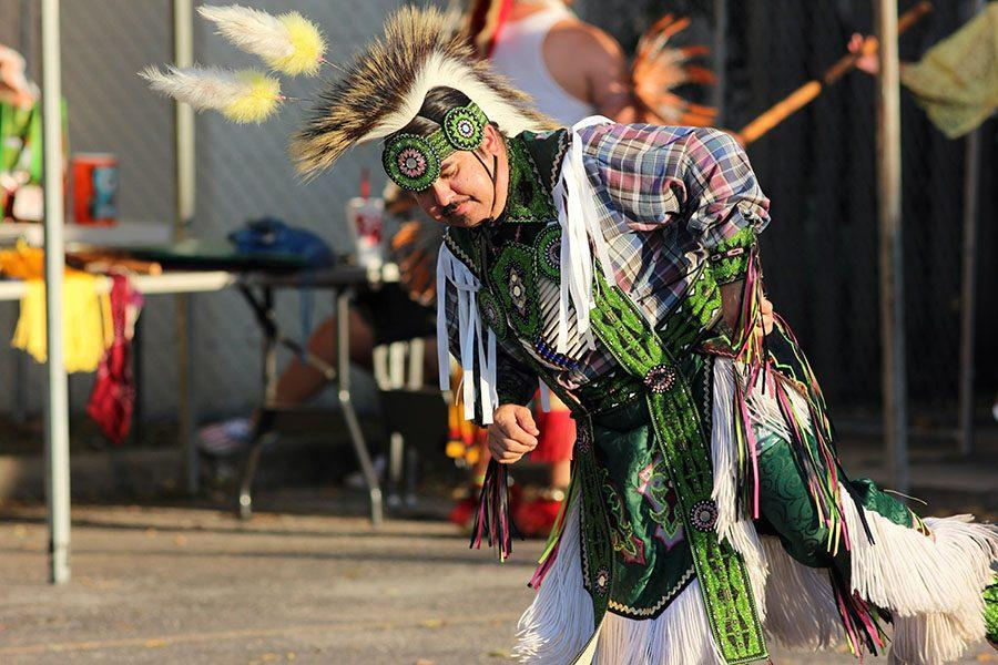 A member of the Tribal Traditions Dance Troupe performs his traditional dance.