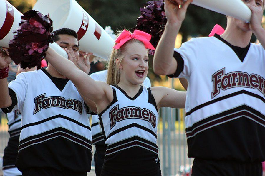 National Champion Lewisville cheerleaders excite the crowd as they head to the community pep rally following the parade.