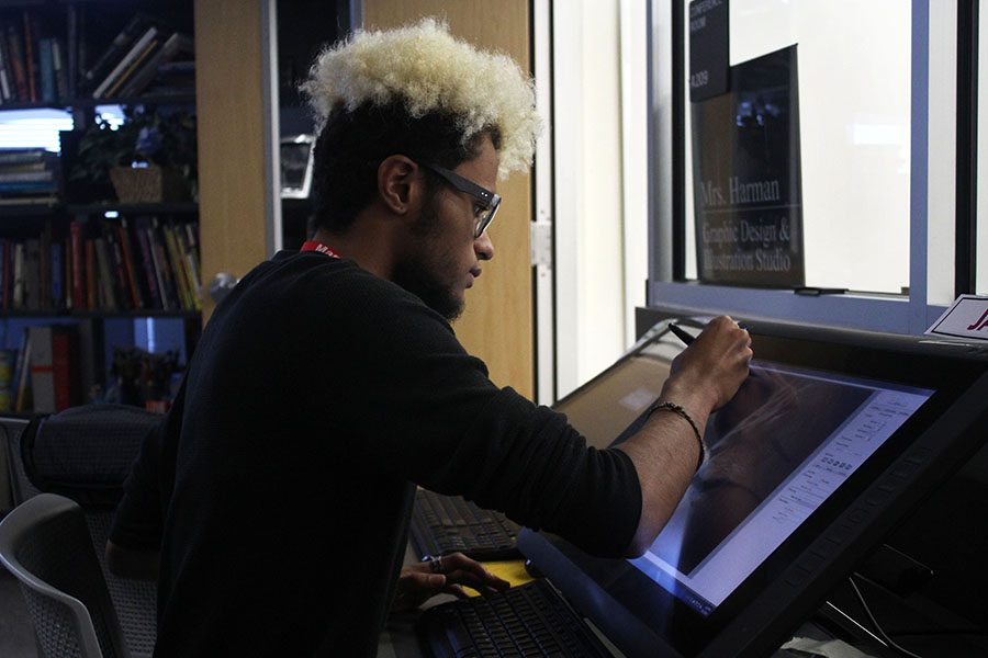 Senior Javon Dixon works intently on his project for graphic design.