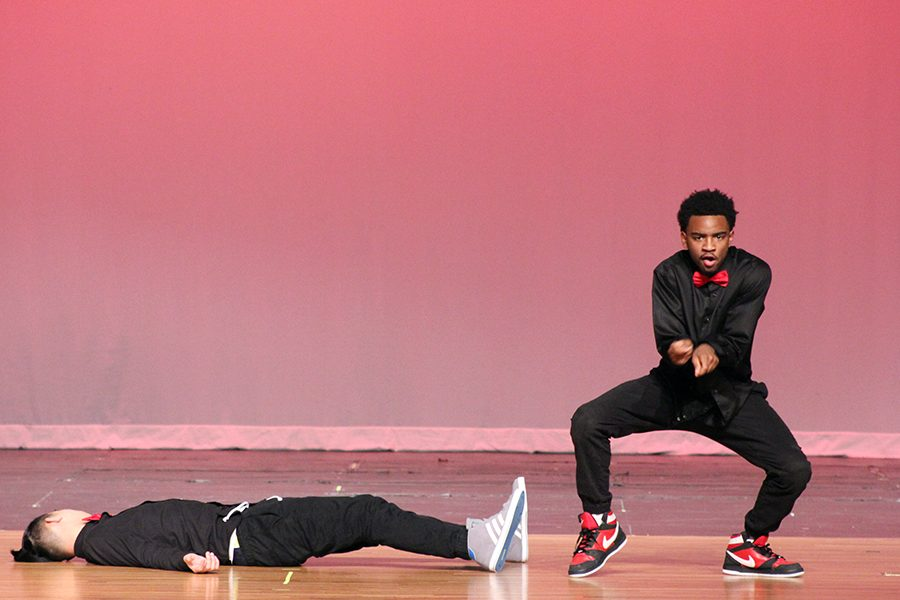 Legacy Dance Crew members, junior Jeremiah Rowe and senior Phong Tran, show off their moves to Holiday Mix.