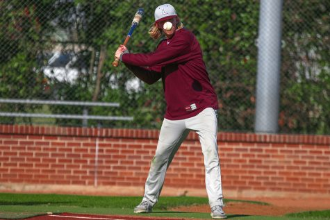 Senior Chris Giordano (16) practices batting on Thursday, Feb. 9 for the scrimmage against Colleyville Heritage on Saturday, Feb. 11.