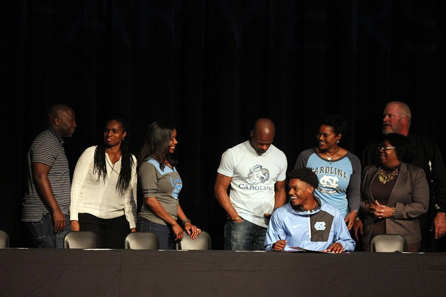 Jadon Johnson commits to track at the University of North Carolina surrounded by his family.