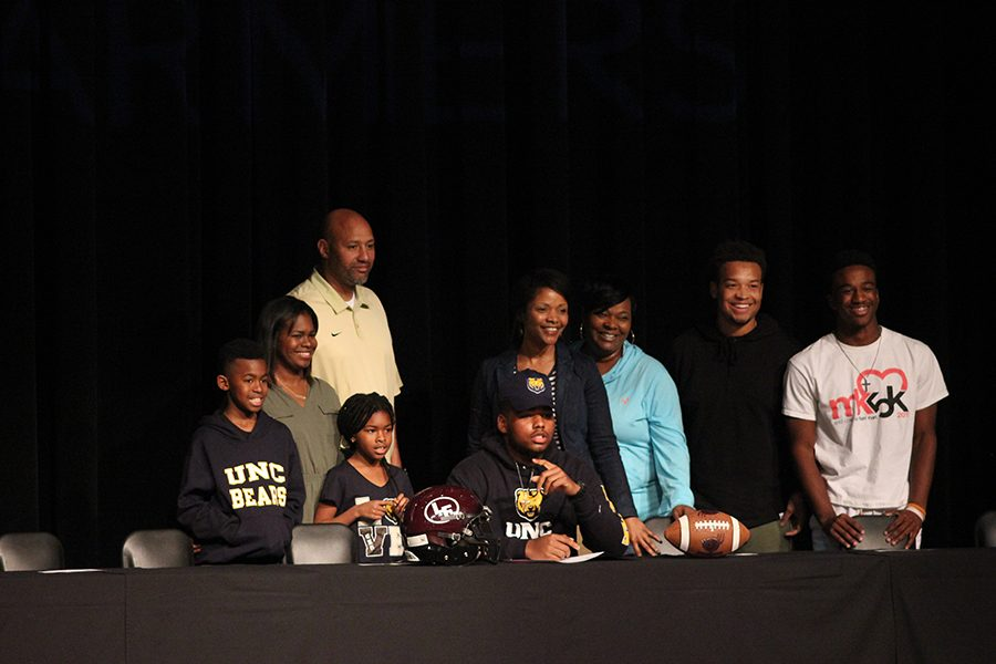 Khristian Lee signs to play football for the University of Northern Colorado.