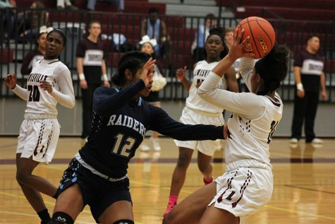 Junior McKenzie Bowie (24) looks to pass the ball to senior Sharmaine Harper (20) or sophomore Nala Hemingway (15) during the L.D. Bell game on Friday, Feb. 3.