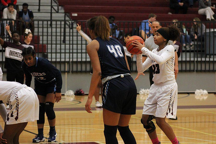 Sophomore Anessa Boyd (23) concentrates as she prepares to make her free throw.