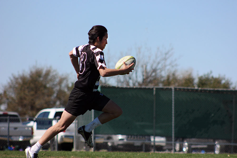 runs into the try zone, scoring the first try of the year.