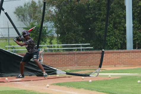 Senior Patrick Bethea practices batting during fourth period on Tuesday, April 25.