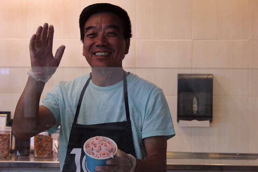 Employer LiuBao Chang greets customers.