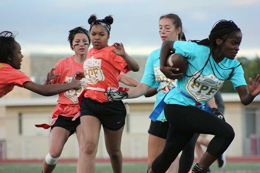 Junior Diamond Taylor sprints past seniors as she attempts to score a touchdown.