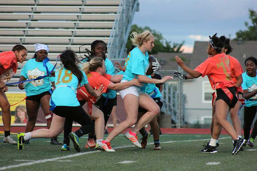 Junior Amber Crews rushes to score for the juniors as her teammates try to block the opponents tackle.