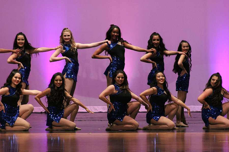 Senior officer Marybeth Rodriquez group members pose as they finish their routine to Love Never Felt so Good.