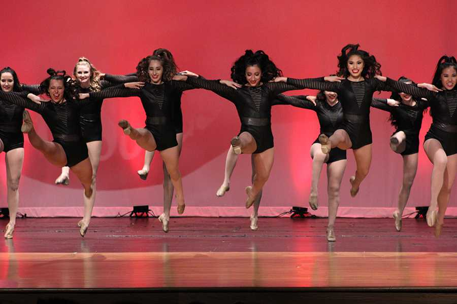 The Farmerette specialty kick team performs its routine to Thunderstruck.