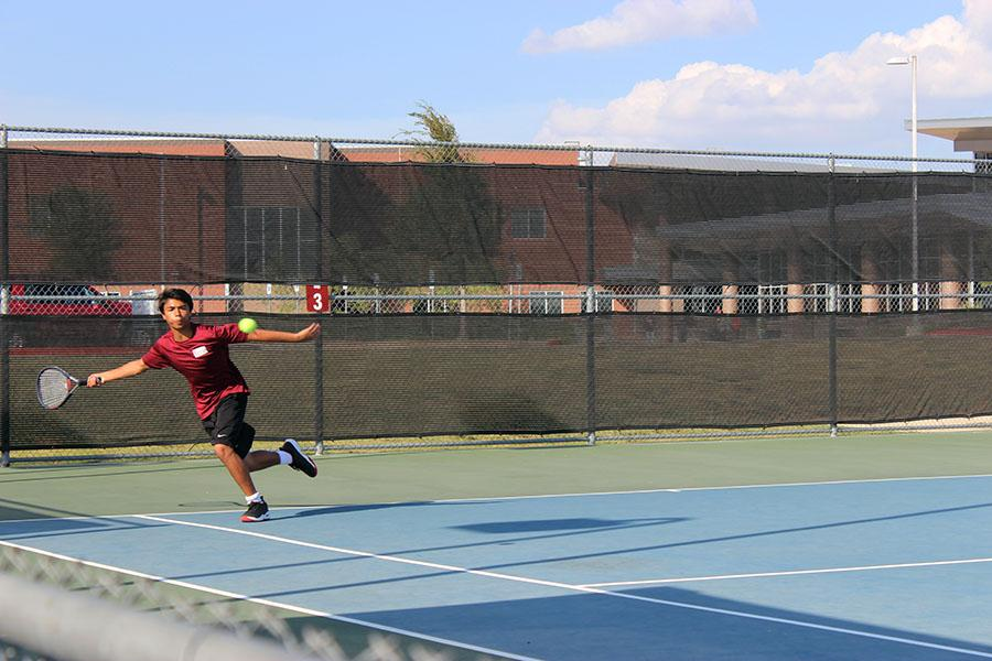 Sophomore Andre Cardenas reaches for the ball.