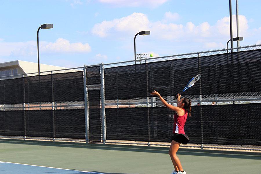 Sophomore Maritoni Songco prepares to serve the ball.