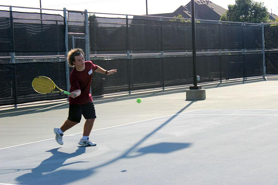 Junior Michael Madonca prepares to hit the ball.