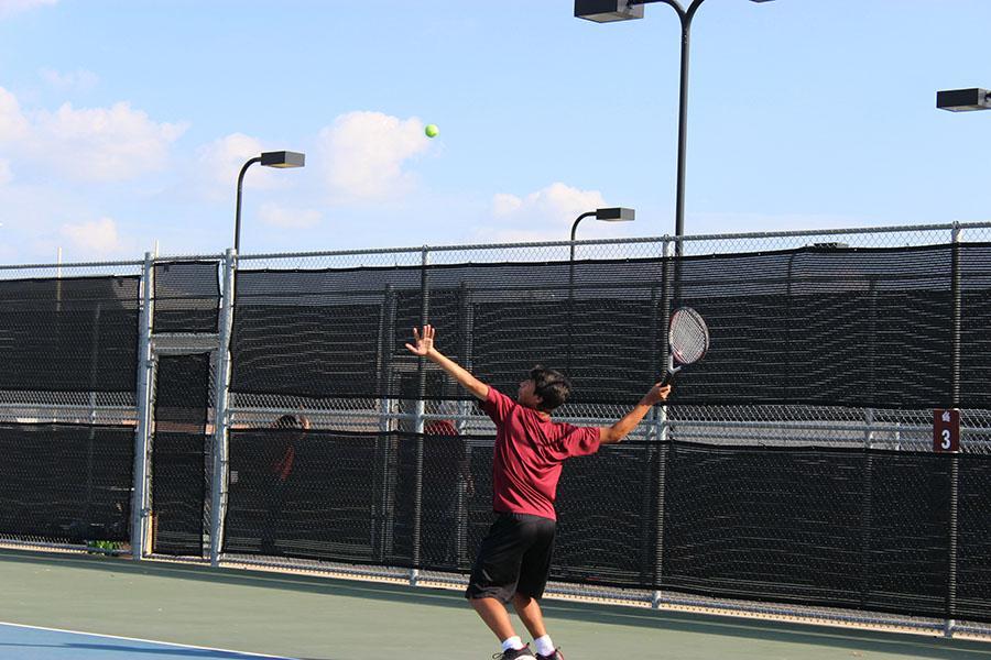 Sophomore Andre Cardenas prepares to serve