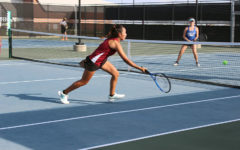 Sophomore Maritoni Songco reaches for the ball.