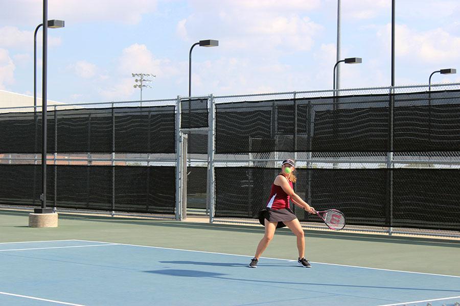 Sophomore Emily Johnke backhands the ball during warm up.