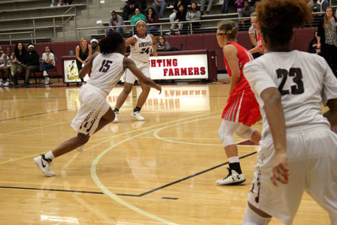 Junior Nala Hemingway (15) runs the play during the game against Marcus on Tuesday, Dec. 19.