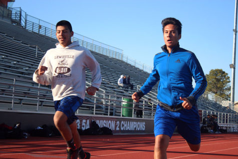 Freshman Kevin Vazquez and sophomore Bryan Hernandez run the track during practice on Wednesday, Feb. 7.