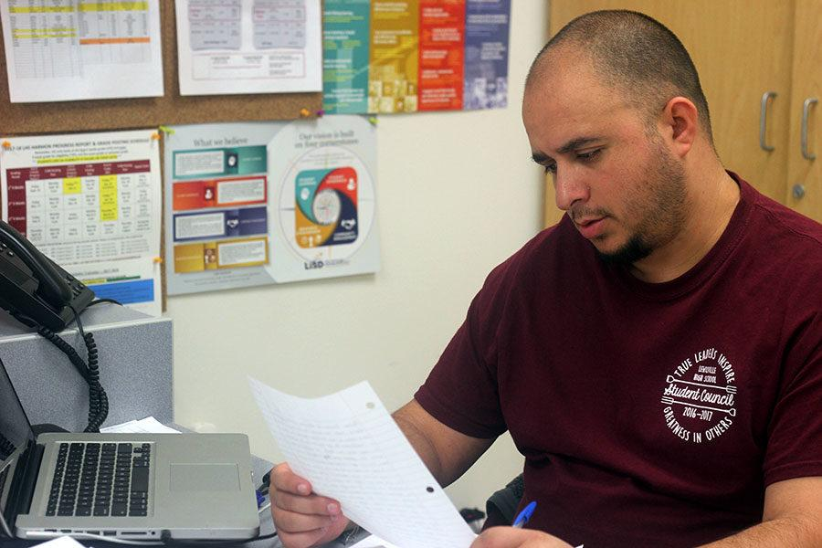 Spanish Teacher Jose Dominguez grades papers during second period on Friday, Feb. 9.