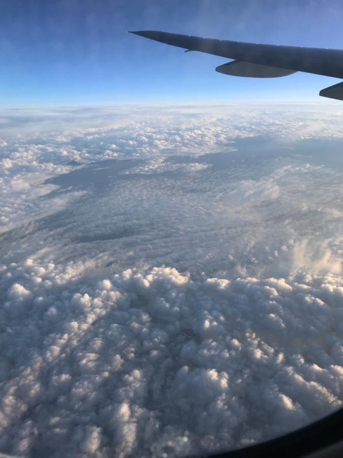 the clouds on the plan to paris