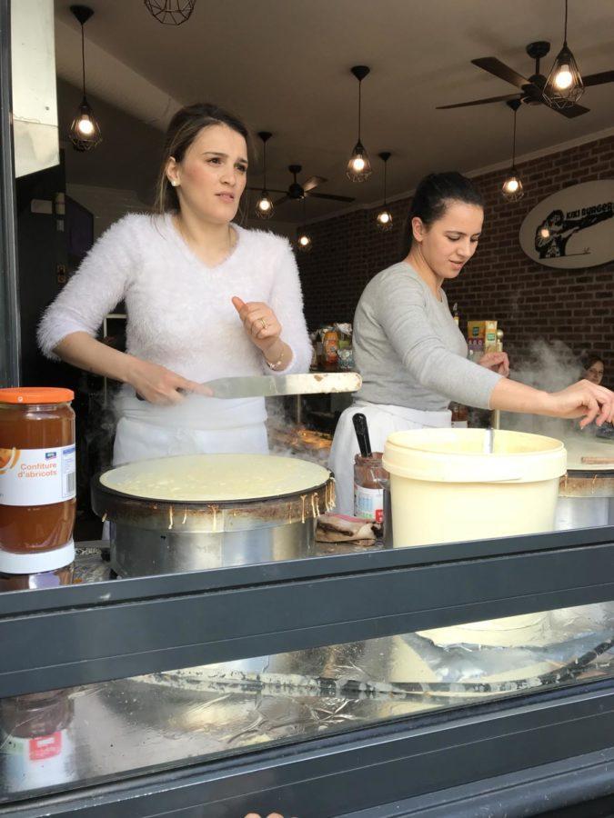 2 crepe workers preparing food