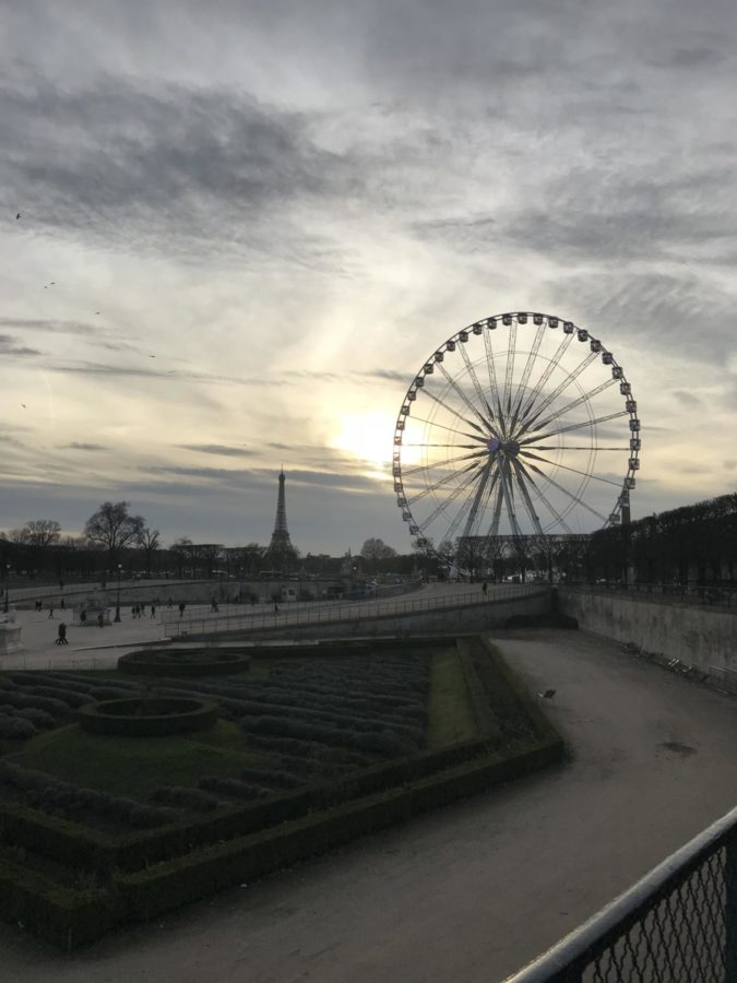 feris wheel and the eiffel tower out in the distance
