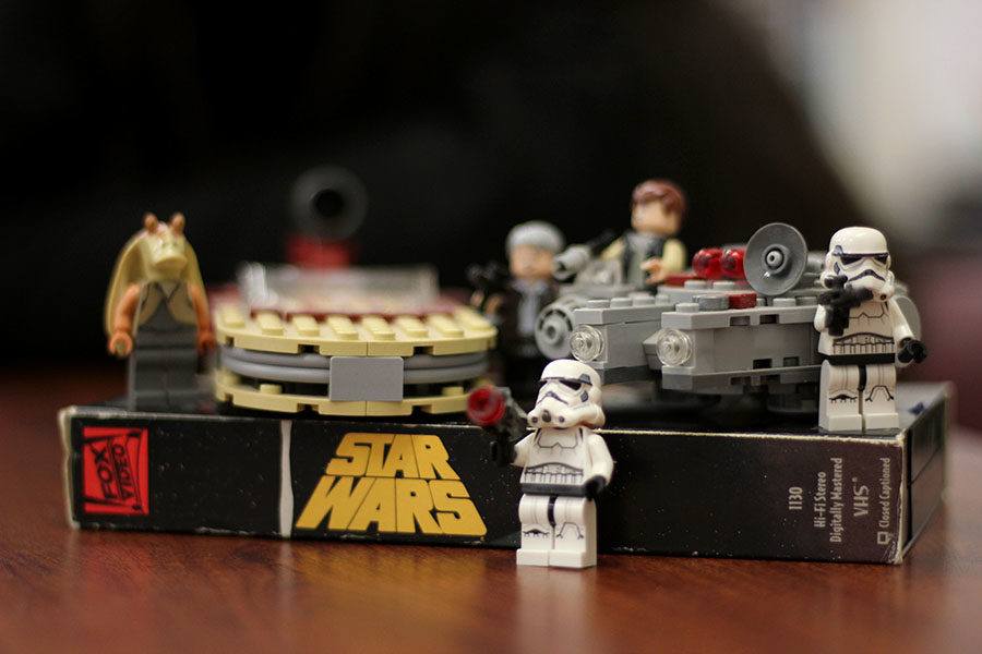 Starwars Lego figures are placed on top of a Starwars VHS tape. Photo illustration by Dallas Nguyen.
