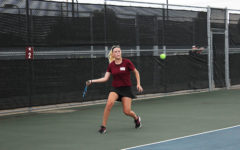 Junior Sasha Jennings sets up for a forehand during the match against Coppell on Tuesday, Sept. 11.