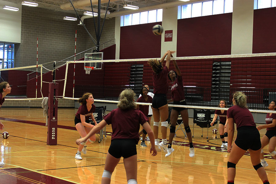 Senior Isis Williams spikes the ball during first period practice on Wednesday, Sept. 19.
