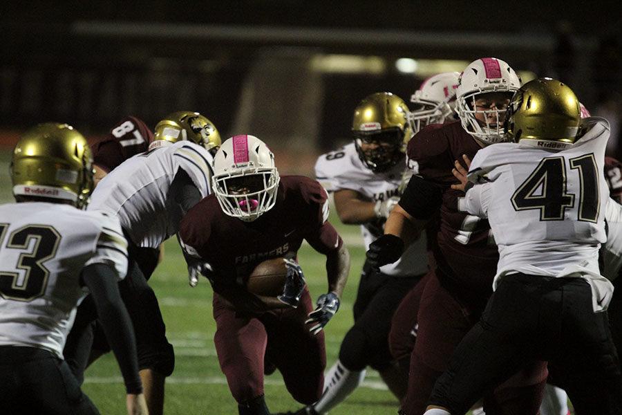 Junior Julius Campbell (25) scores a touchdown.