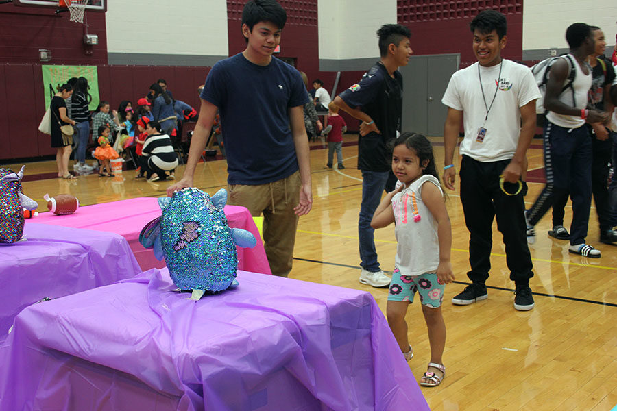 Children participate in knocking down the sets of bears.
