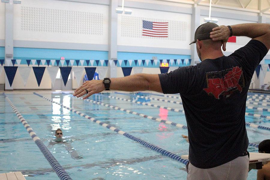 Head swim coach Craig Harris demonstrates the right movement for a cutaway.