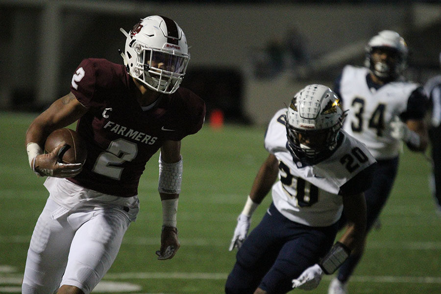 Senior defensive back Kevin Anderson (2) attempts to make it to the end zone before getting tackled by Keller players.