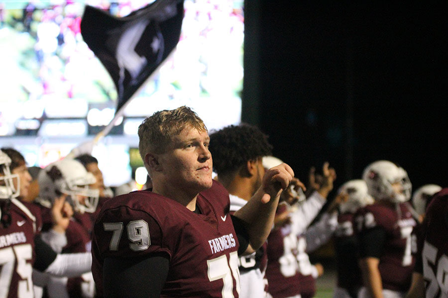 Senior Logan Lewis (79) looks into the crowd as the school song plays.