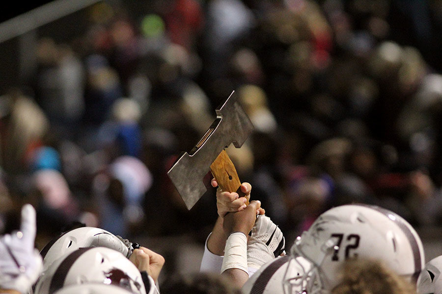 The Fighting Farmer football team holds the ax above their heads to celebrate winning the rivalry game against the Marcus Marauders on Friday, Nov. 9.