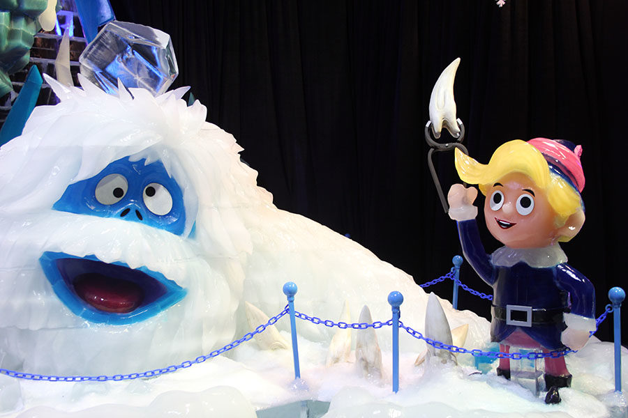 Hermey the Elf helps the snow monster pull out his cavity.