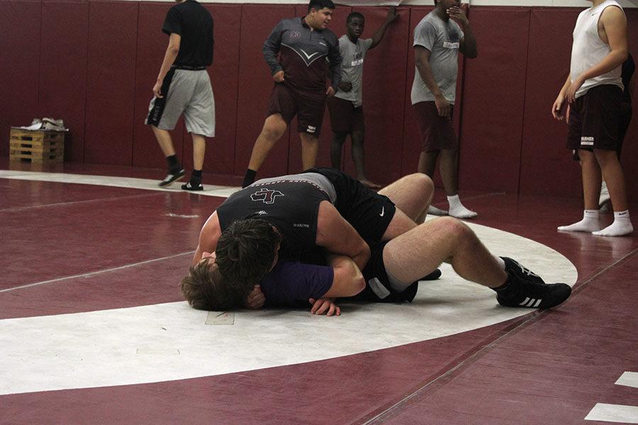 Juniors Luke Halter and Dylan Adams practice in the wrestling room after school on Monday, Dec. 10.