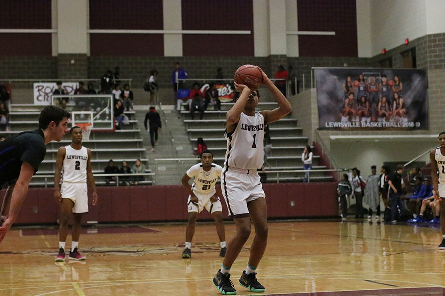 Freshman guard Keyonte George (1) shoots a free throw which helped the team get in the lead.